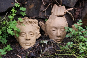 BACK TO THE EARTH - Terracotta - I decided not to finish these two heads so they are going back to the earth in the garden.  They are going the way of all things.